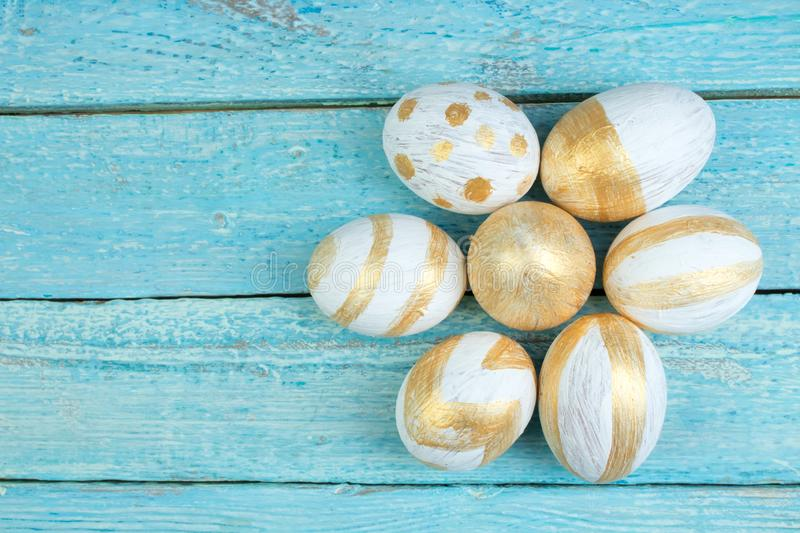 Happy Easter. Painted eggs on wooden table. Top view. Copy space for text. royalty free stock photos