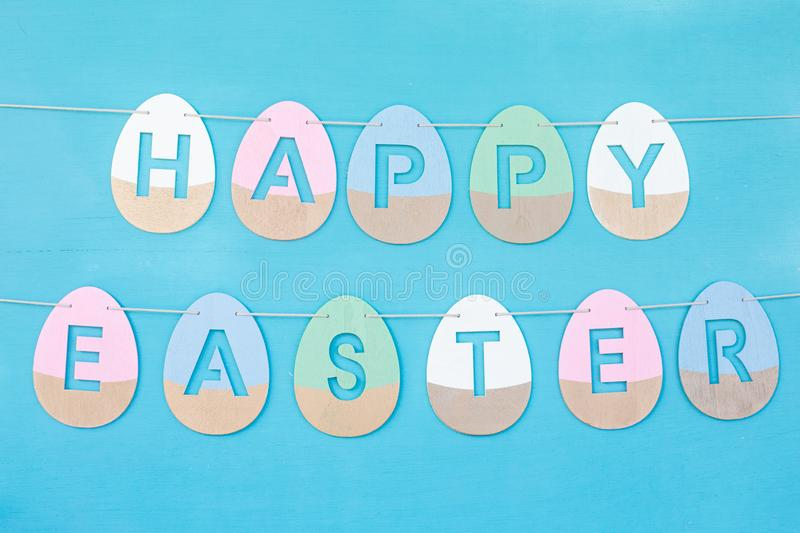 Happy Easter phrase made from wooden coloured eggs stock photos