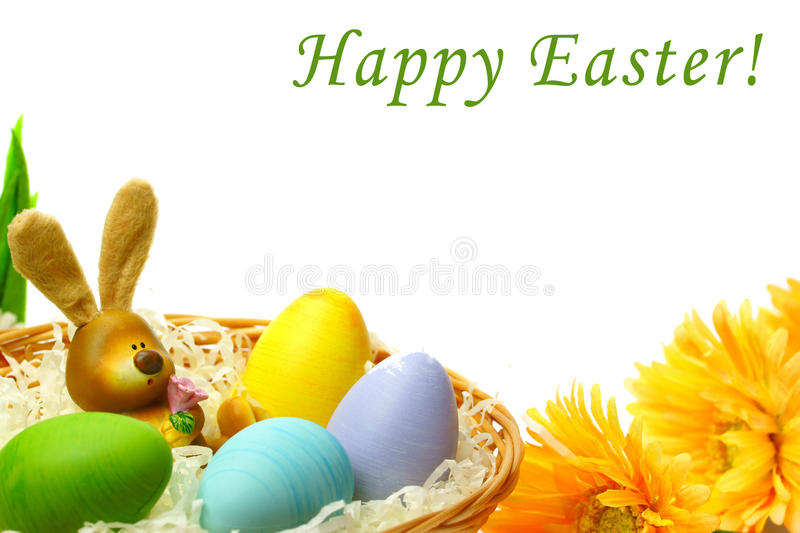 Happy Easter. Rabbit with colorful Easter eggs and yellow flowers on white background stock photo