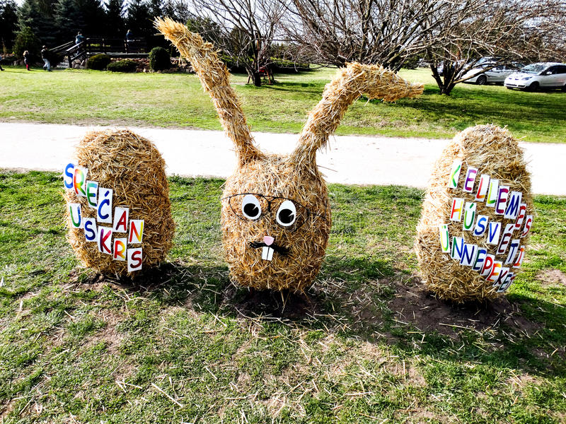 Happy Easter. Rabbit and two eggs made of straw for Easter holidays royalty free stock images