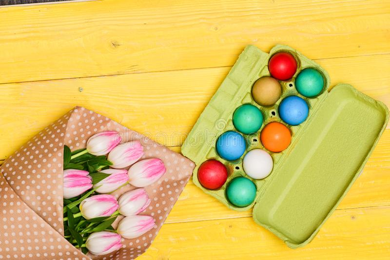 Happy easter. Spring holiday. Holiday celebration, preparation. Tulip flower bouquet. Healthy and happy holiday. painted. Eggs in egg tray. Egg hunt. Easter royalty free stock photos