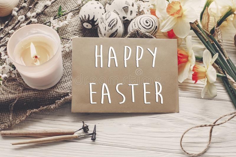 Download Happy Easter Text Flowers Daffodils And Stylish Eggs On Rustic Stock Photo