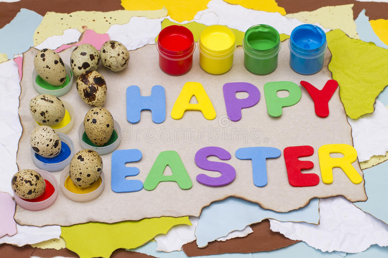 Happy Easter on torn and burnt paper with blots and eggs and gouache royalty free stock photography