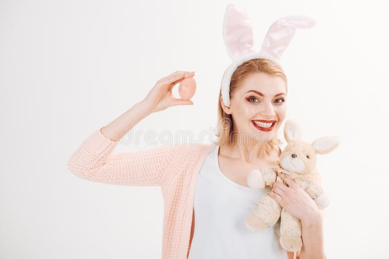 Happy easter. Woman in rabbit bunny ears. happy woman in bunny ears with toy. Spring holiday. Girl with hare toy. Egg. Hunt. Easter eggs as traditional food royalty free stock photo