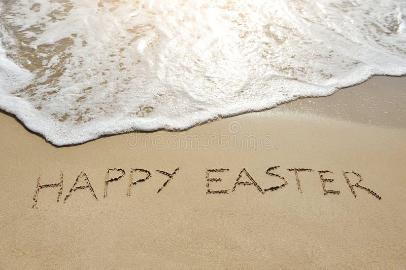 Happy easter written on sand stock photos