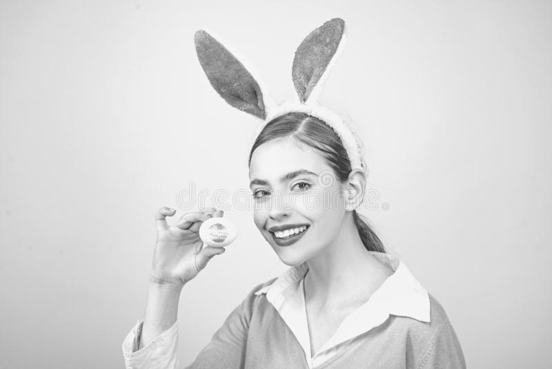 Happy easter. Young woman in rabbit bunny ears. Easter bunny woman, rabbit and girl. Lipstick kiss print on easter egg. royalty free stock photos
