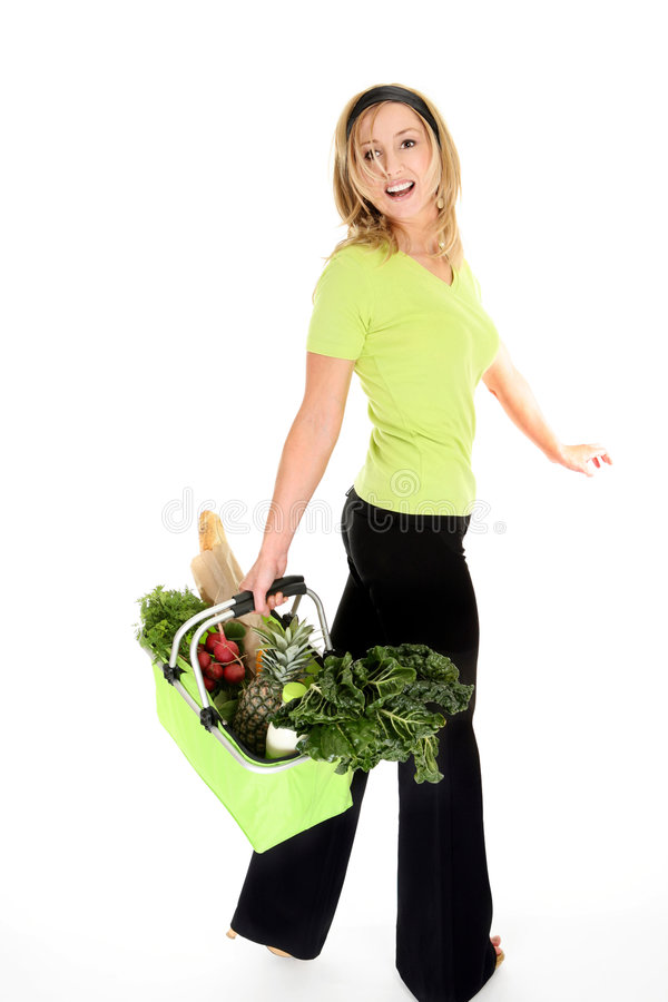 Happy Eco Shopper. A girl with an eco friendly reusable shopping bag filled with fresh fruit and vegetables, milk and bread. Bag collapses and folds flat when stock photography