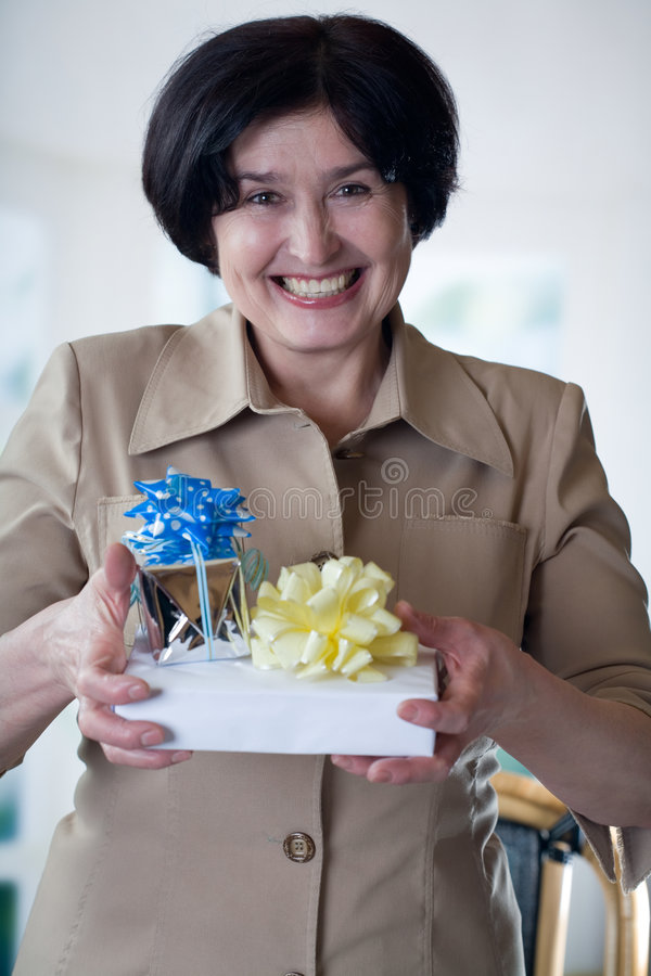 Happy elderly attractive woman with giftboxes stock photo