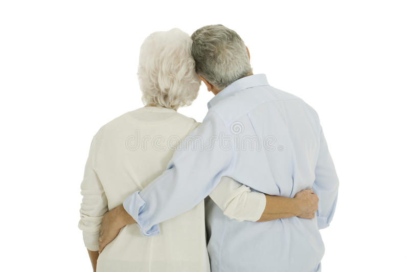 Happy elderly couple embraced from behind stock images