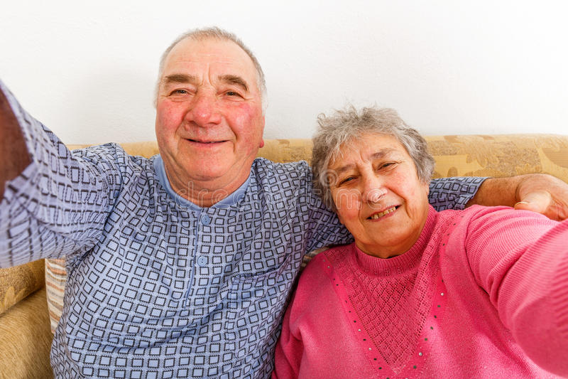 Happy elderly couple. Smiling for the camera royalty free stock image