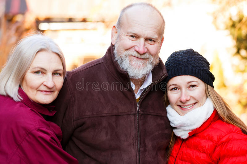 Happy elderly couple and the young carer. Happy elderly couple with the young carer stock photos