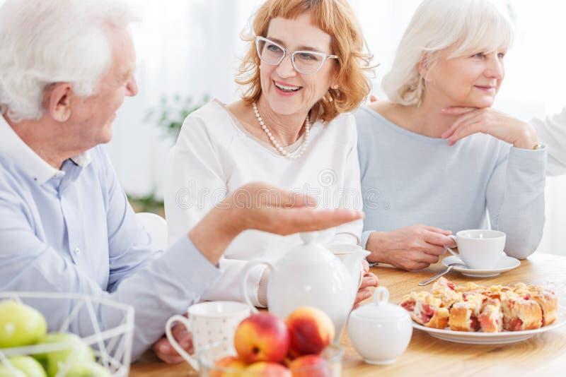 Happy elderly friends enjoying retirement royalty free stock photos