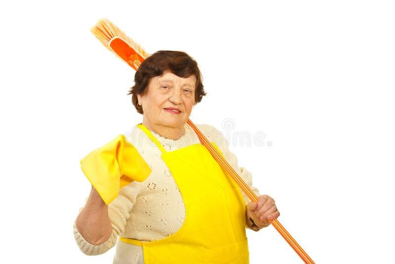 Happy elderly housewife stock photos