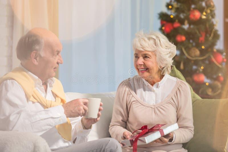 Elderly people giving presents stock photos