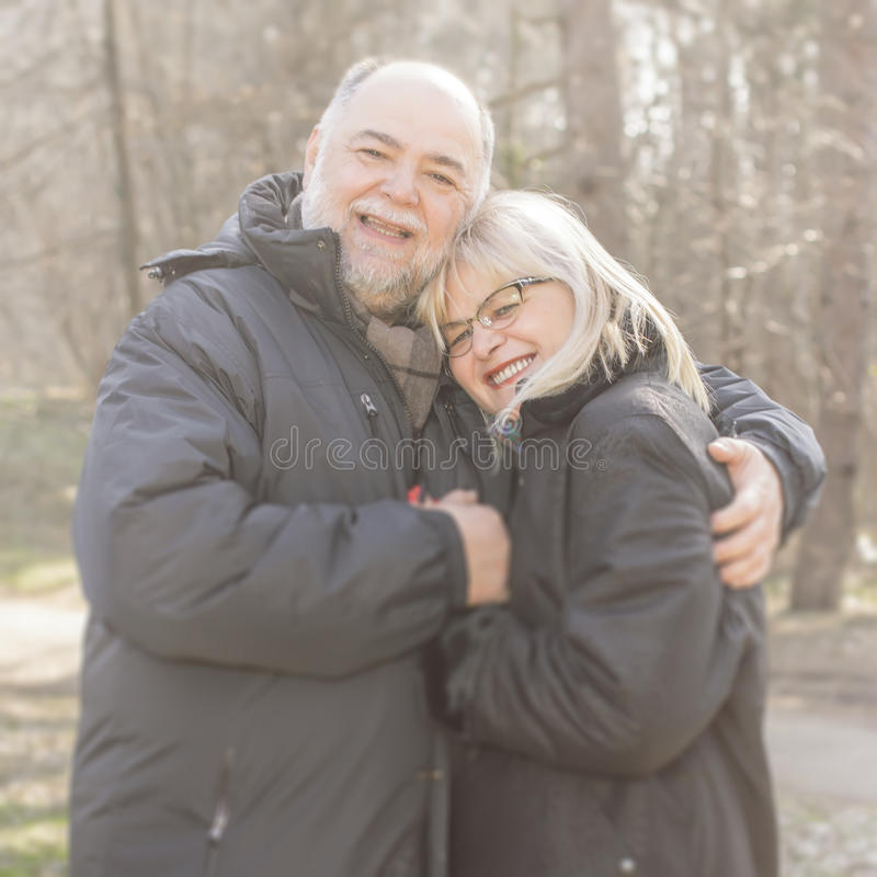 Happy Elderly Senior Couple Emracing stock image