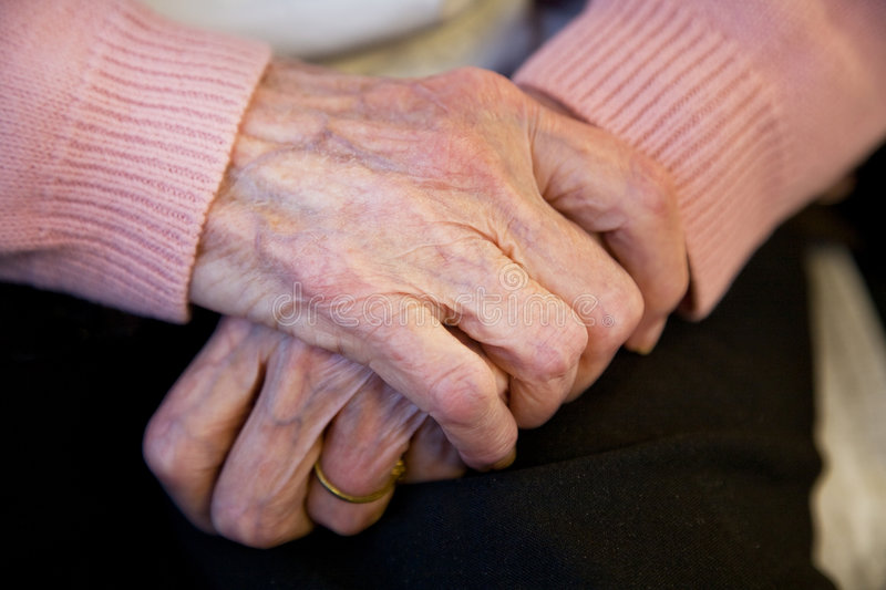 Happy elderly woman close up of hands royalty free stock photos