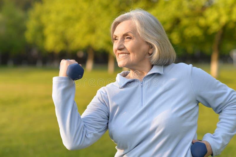 Happy elderly woman doing sports royalty free stock image