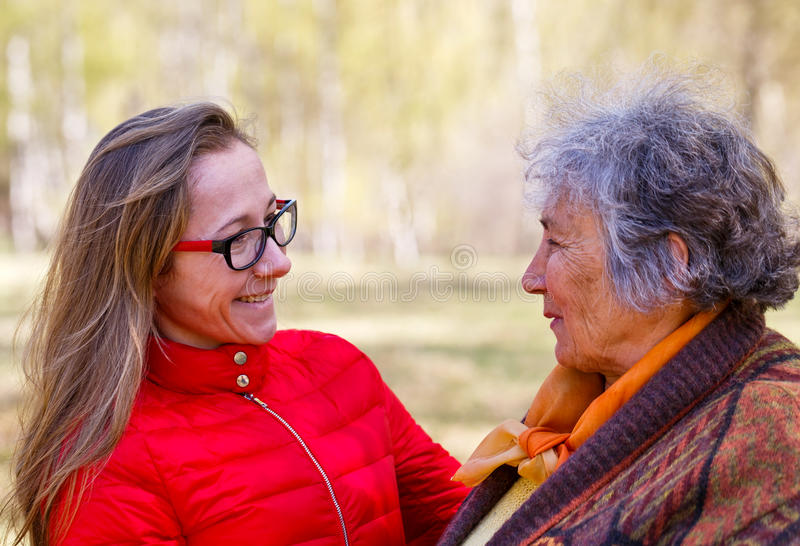 Happy elderly woman with her daughter. Photo of happy elderly women with her daughter royalty free stock image
