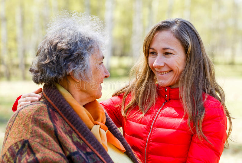 Happy elderly woman with her daughter. Photo of happy elderly women with her daughter royalty free stock photo