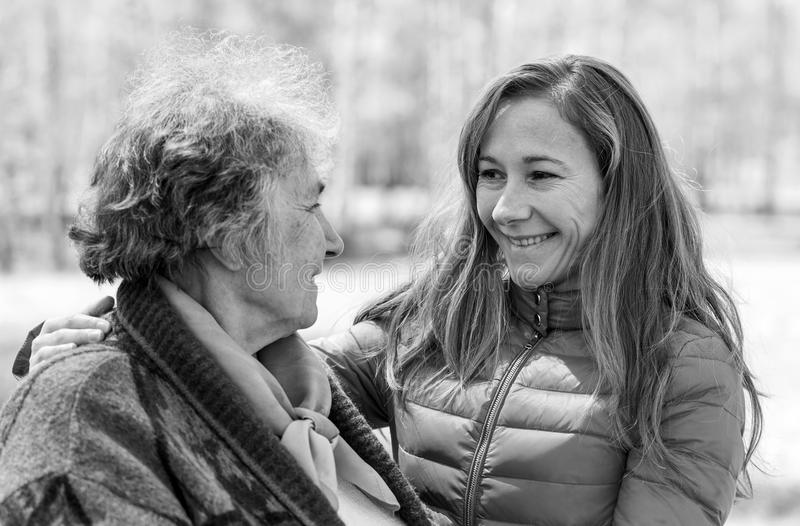 Happy elderly woman with her daughter. Portrait photo of happy elderly women with her daughter royalty free stock images