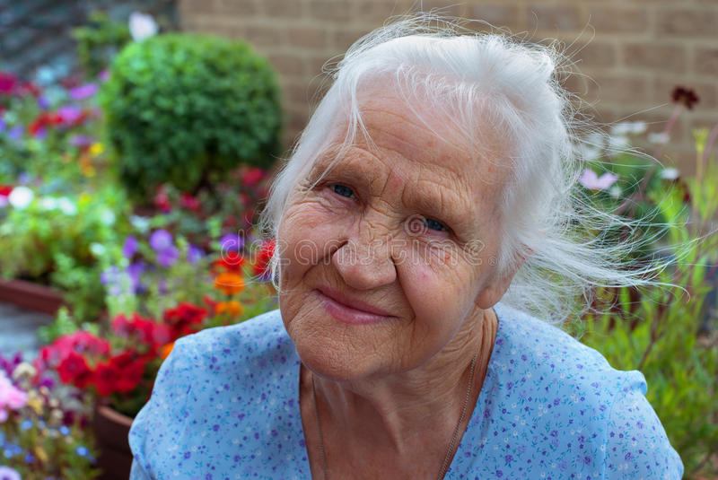 Happy elderly woman stock images