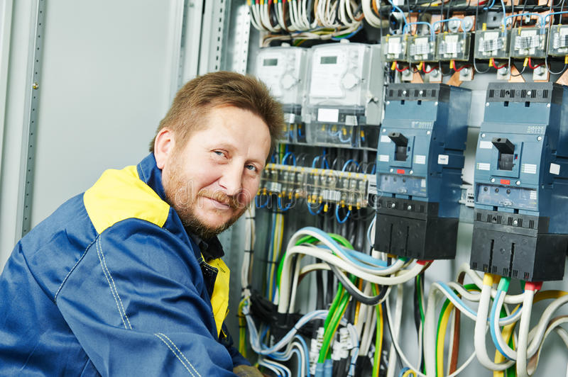 Happy electrician engineer worker royalty free stock image