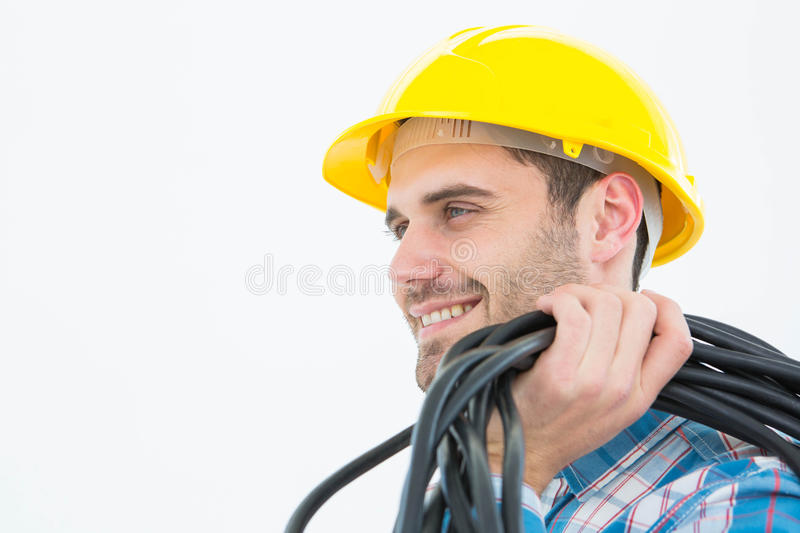 Happy electrician with wires. Close-up of happy electrician with wires over white background stock photos