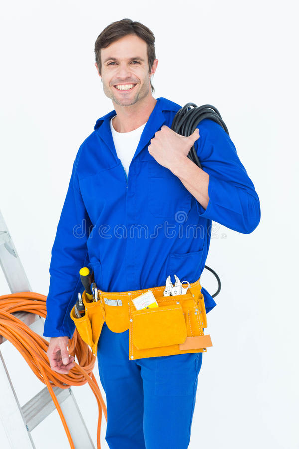 Happy electrician with wires over white background royalty free stock image