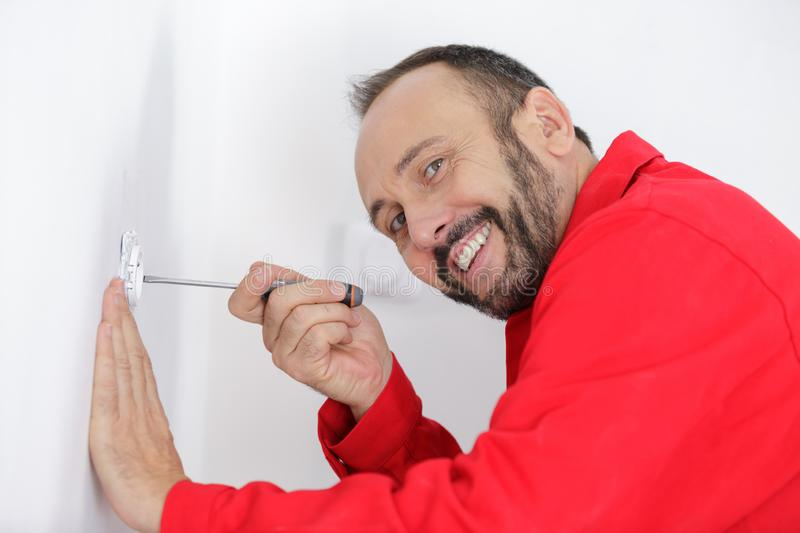 Happy electrician at work royalty free stock image