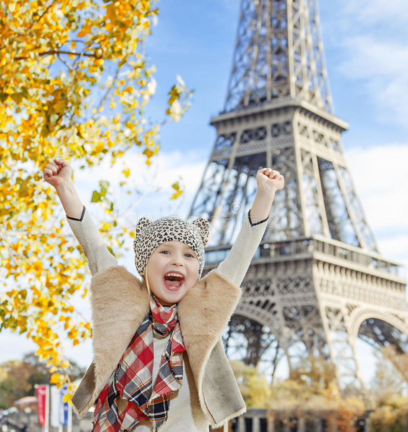 Happy elegant child on embankment in Paris, France rejoicing stock photo
