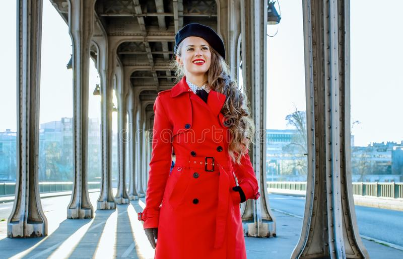 Happy elegant tourist woman in Paris looking into the distance royalty free stock photography
