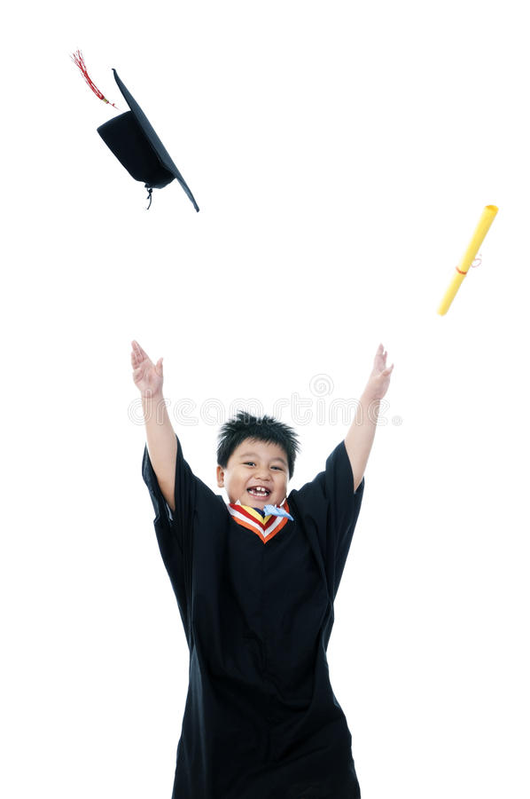 Happy elementary schoolboy jump with hands raised stock image