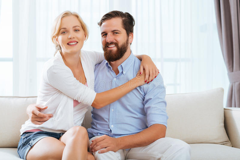 Happy embracing couple stock photos