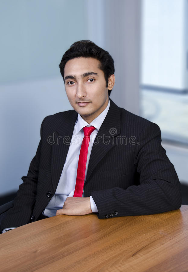 Happy Employee. A satisfied smiling employee sitting in cabin stock images