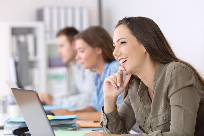 Happy employee imagining at office royalty free stock photography