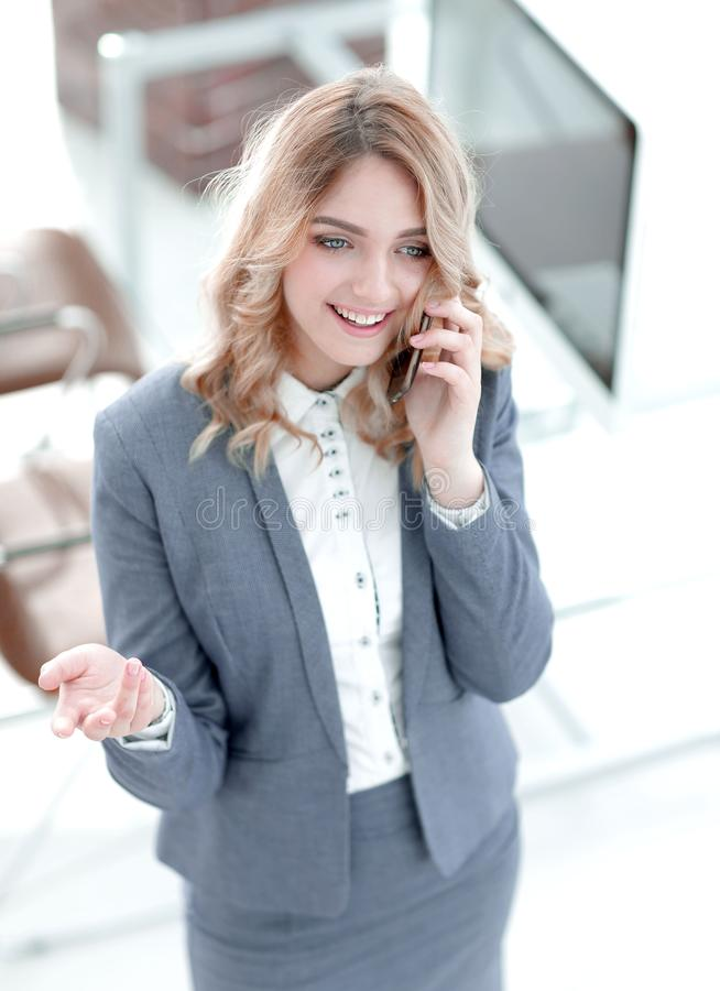 Happy employee is talking on the smartphone stock photos
