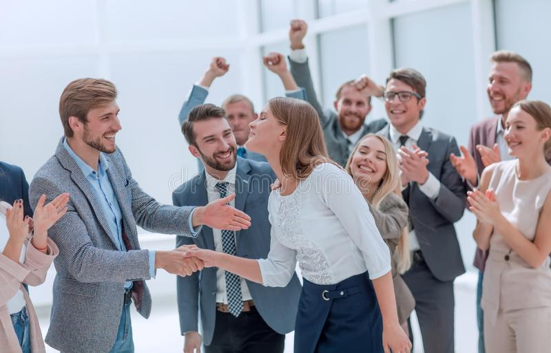 Happy employees congratulating their leader. the concept of victory stock images