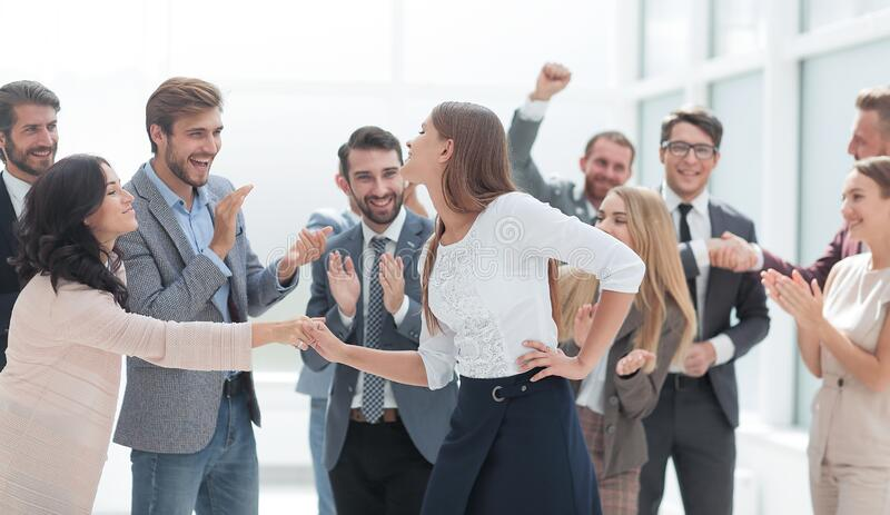 Happy employees congratulating their leader. the concept of victory stock photo