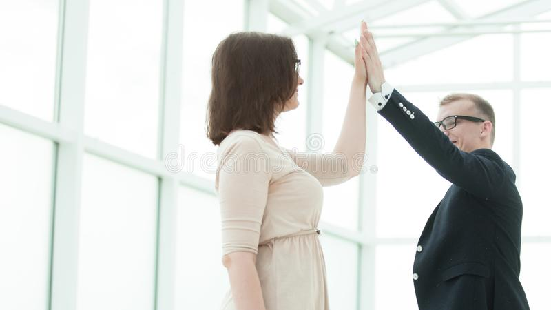 Happy employees giving each other high five stock images