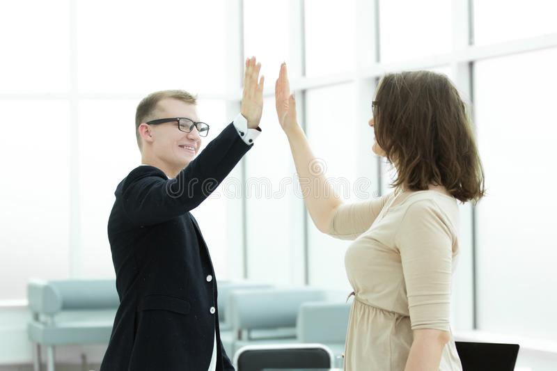 Happy employees giving each other high five royalty free stock image