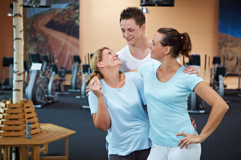 Happy employees in gym royalty free stock photography