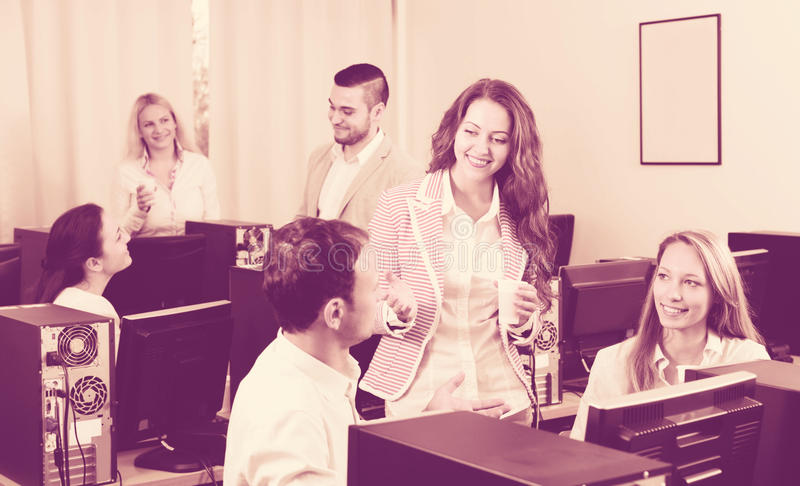 Happy employees and manager celebrating royalty free stock image