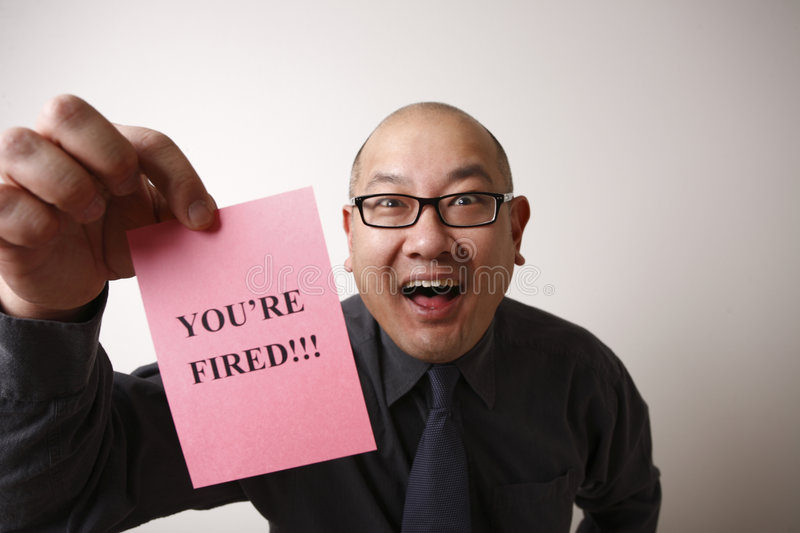 Happy employer with pink slip royalty free stock photography