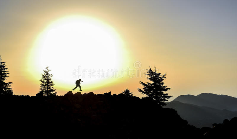 Happy energetic start to the day at the peak of the mountain. Sunrise in nature and peace.sunrise freshness of the woods.fascinating sunrise at the summit of the royalty free stock photo
