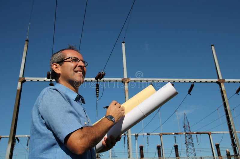 Happy Engineer Next to Electrical Substation. royalty free stock photo