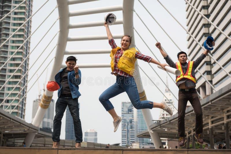 Happy engineer team jump in city stock image