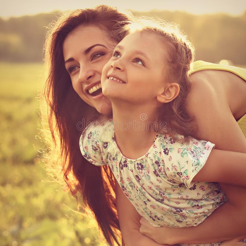 Happy enjoying mother hugging her playful laughing kid girl on s royalty free stock images