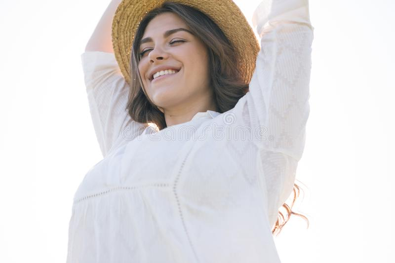Happy enjoying smiling woman portrait. Closed eyes. Relaxed dreamy mood. royalty free stock photo