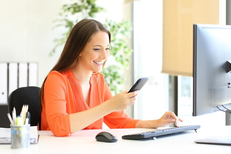 Entrepreneur checking phone message at office stock images