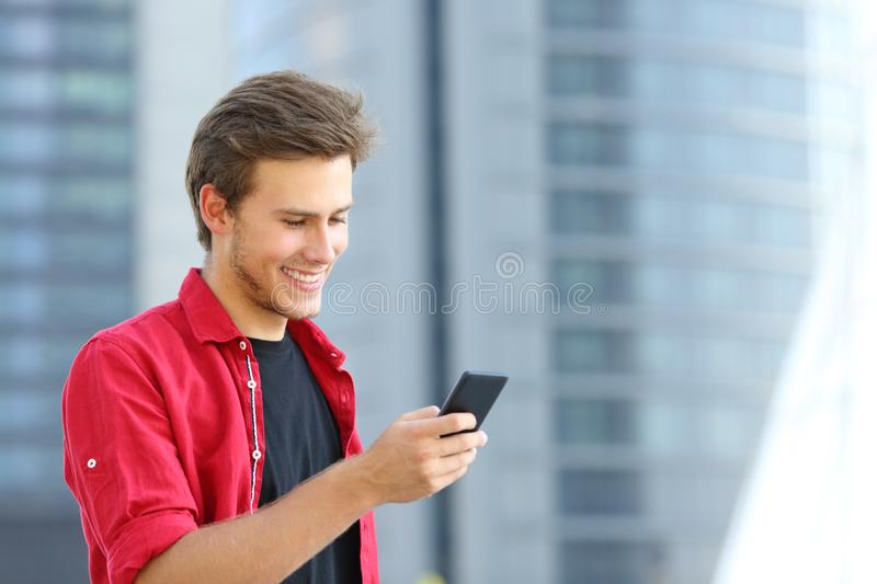 Happy entrepreneur using smart phone in the street royalty free stock photo
